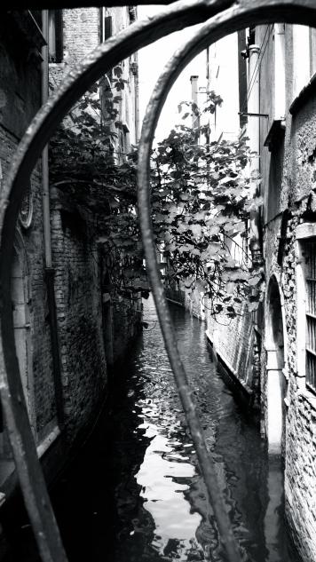 View of Canal through railings, Santa Lucia, Venice